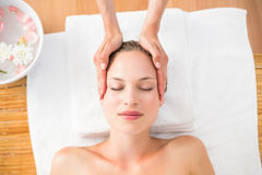 pretty blonde receiving head massage Royalty Free Stock Image