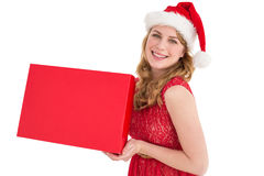 Pretty blonde in red dress holding a box Royalty Free Stock Image