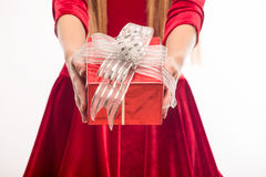 Pretty blonde in red dress holding a box on white background Stock Photography
