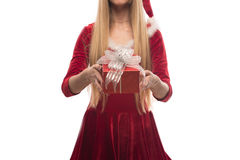 Pretty blonde in red dress holding a box on white background Stock Image