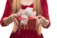 Pretty blonde in red dress holding a box on white background Royalty Free Stock Photography