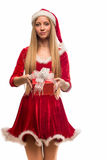 Pretty blonde in red dress holding a box on white background Stock Photos