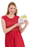 Pretty blonde in red dress showing her cash Royalty Free Stock Photo