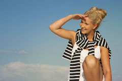 Pretty blonde sail woman looking sideways and smile Stock Image