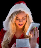 Pretty blonde in santa outfit opening gift Stock Photos