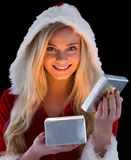 Pretty blonde in santa outfit opening gift Stock Photography