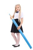 Pretty blonde schoolgirl with big blue pencil Royalty Free Stock Photography