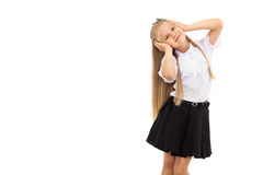 Pretty blonde schoolgirl isolated on a white background Stock Photo