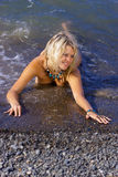 Pretty blonde in the sea. Stock Photography