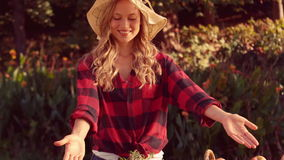 Pretty blonde selling organic vegetables stock footage