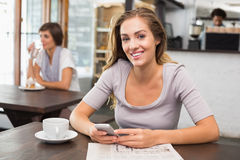 Pretty blonde sending text message Royalty Free Stock Images