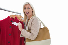 Pretty blonde shocked at price of jacket Stock Photos