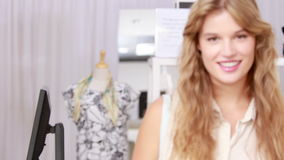 Pretty blonde shopping for clothes stock video
