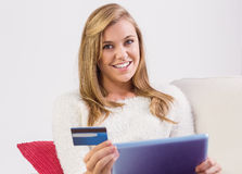 Pretty blonde shopping online with tablet pc Stock Photo