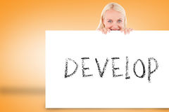 Pretty blonde showing card with develop Royalty Free Stock Images