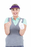 Pretty blonde showing thumbs up. On white background Stock Photo
