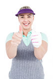 Pretty blonde showing thumbs up. On white background Royalty Free Stock Image
