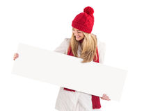 Pretty blonde showing white banner Stock Images
