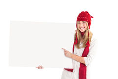 Pretty blonde showing white poster Stock Photography