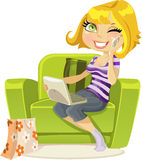 Pretty blonde sitting in a chair talking on phone Stock Images