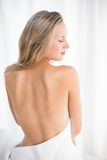 Pretty blonde sitting on massage table Royalty Free Stock Photography