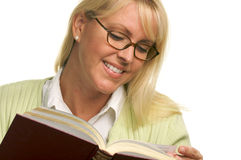 Pretty Blonde Smiles While Reading a Book Stock Image