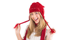 Pretty blonde smiling at camera in warm clothes Stock Image
