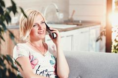 Pretty Blonde Woman Speaking On The Smartphone royalty free stock photo