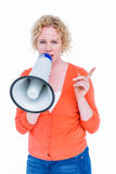 Pretty blonde speaking into megaphone Stock Images