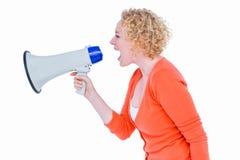 Pretty blonde speaking into megaphone Stock Photos