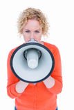 Pretty blonde speaking into megaphone Royalty Free Stock Photo