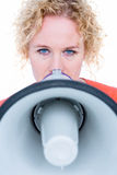 Pretty blonde speaking into megaphone Royalty Free Stock Images