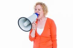 Pretty blonde speaking into megaphone Stock Image