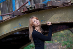 Pretty blonde standing under an old bridge Royalty Free Stock Photography