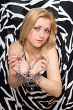 Pretty blonde stretches out her hands in chains Royalty Free Stock Images