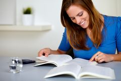 Pretty blonde student girl smiling and learning Royalty Free Stock Photography