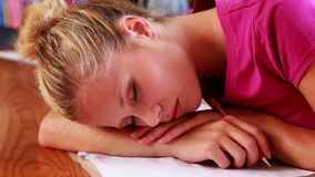 Pretty blonde student sleeping in library Royalty Free Stock Photo