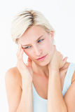 Pretty blonde suffering from neck ache Royalty Free Stock Photography