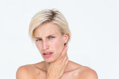 Pretty blonde suffering from throat pain Royalty Free Stock Image