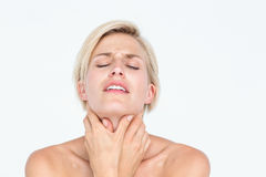 Pretty blonde suffering from throat pain Stock Photography