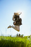 Pretty blonde in sundress jumping up Stock Photos