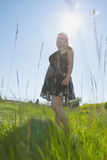 Pretty blonde in sundress smiling at camera Stock Photo