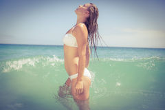 Pretty blonde in swimsuit out of the water Royalty Free Stock Photo