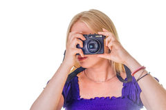 Pretty blonde taking a photograph royalty free stock photo