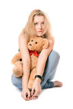 Pretty blonde with a teddy bear Royalty Free Stock Photo
