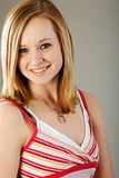 Pretty blonde teen. Alli teen model with shoulder length hair looking pretty in her portrait Royalty Free Stock Images