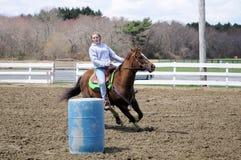 Pretty blonde teenage girl barrel racing Stock Image
