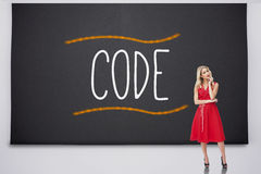 Pretty blonde thinking against code Stock Image