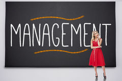 Pretty blonde thinking against management Royalty Free Stock Photography