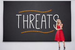 Pretty blonde thinking against threats Royalty Free Stock Images